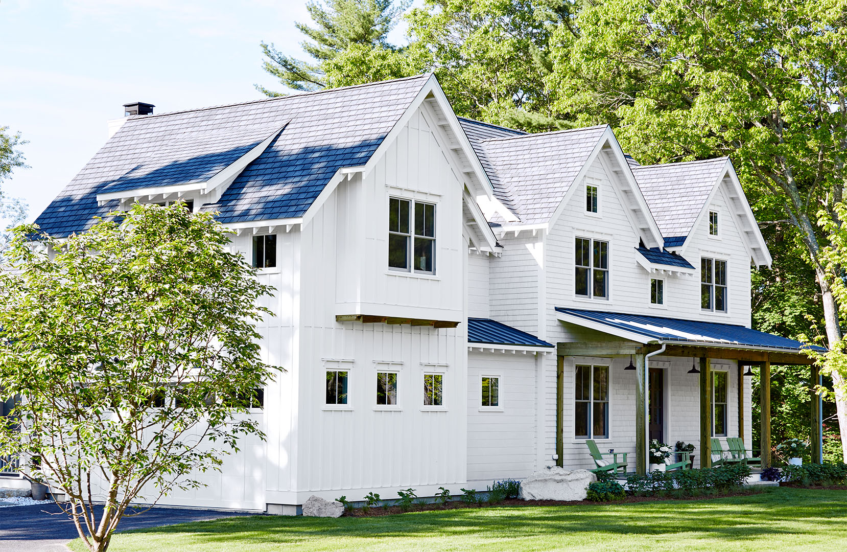 Old and new white farmhouse