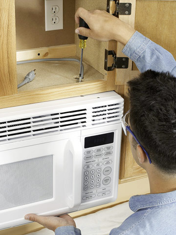 Installing an over the range microwave better homes - How to vent a microwave on an interior wall ...