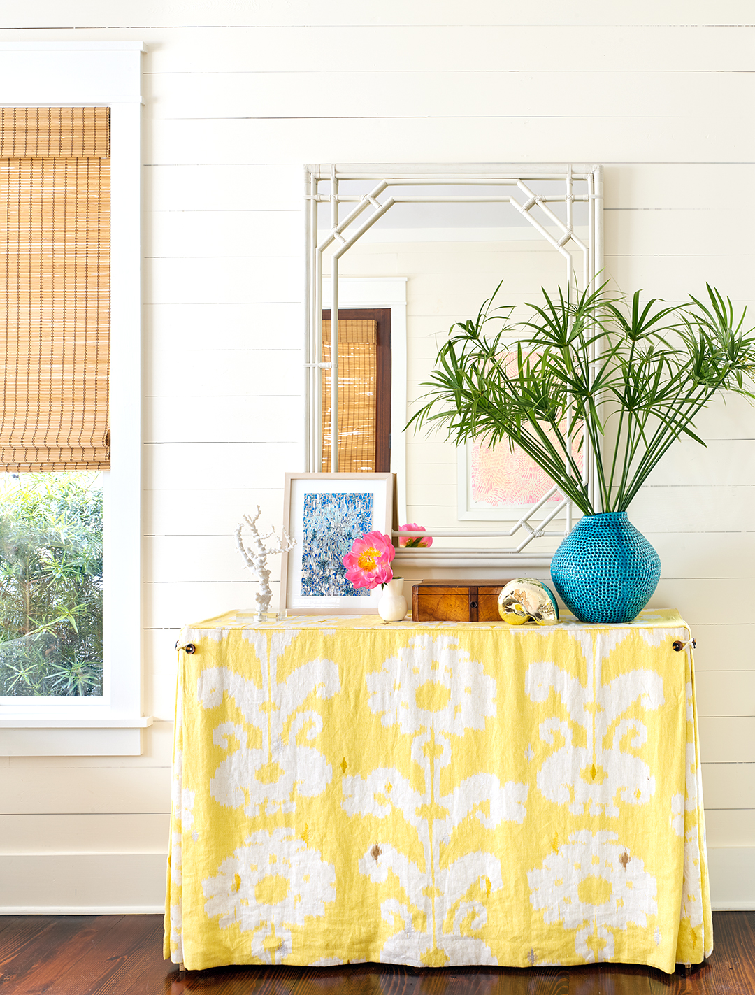 charleston beach home table with yellow table cloth palms and mirror