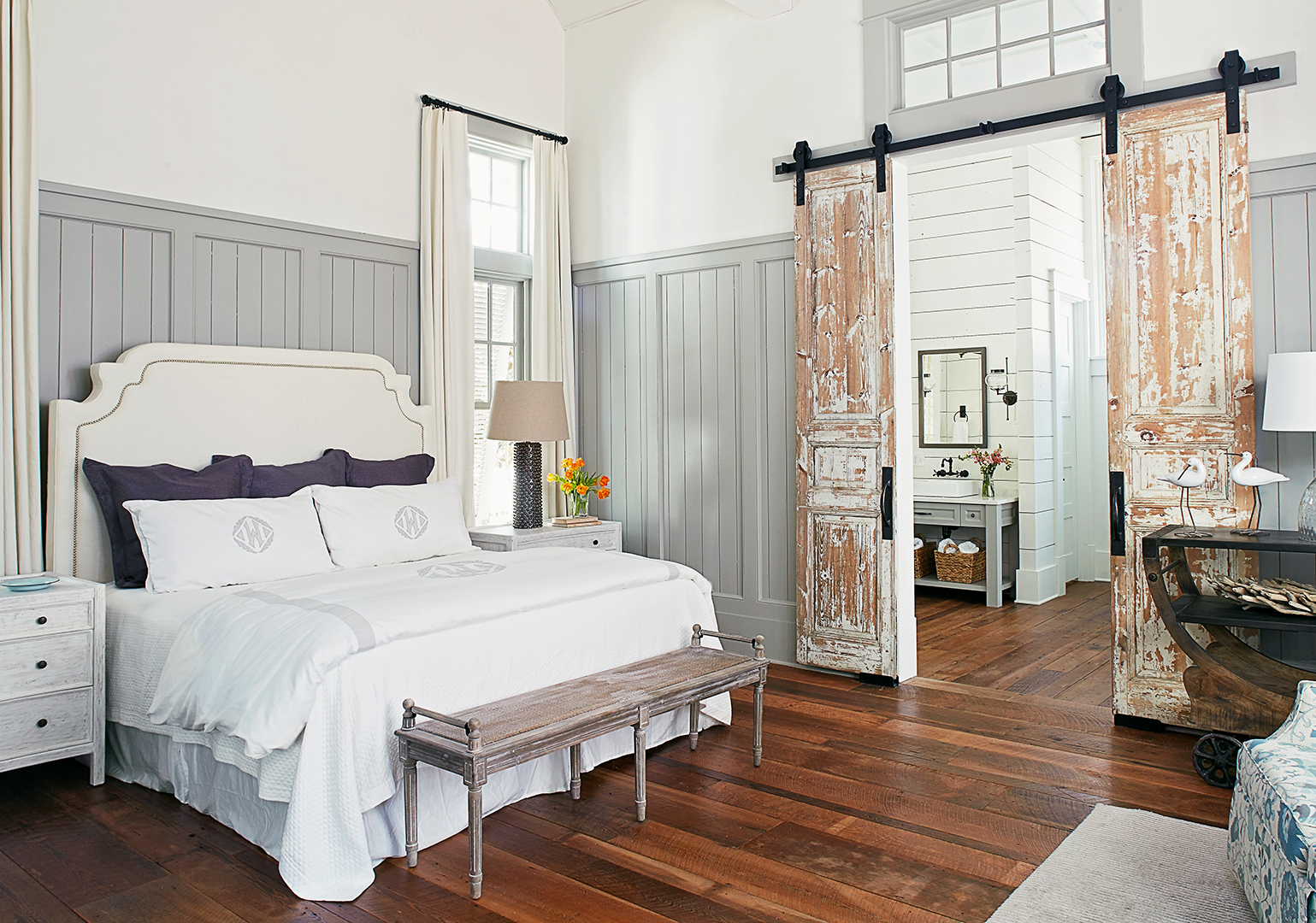 master bedroom with gray walls and sliding doors