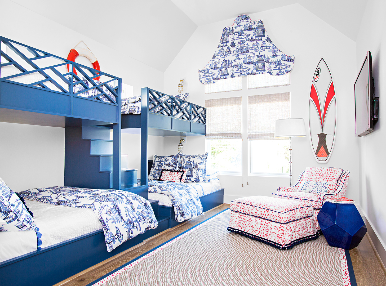 nautical bedroom with 2 sets of blue bunkbeds