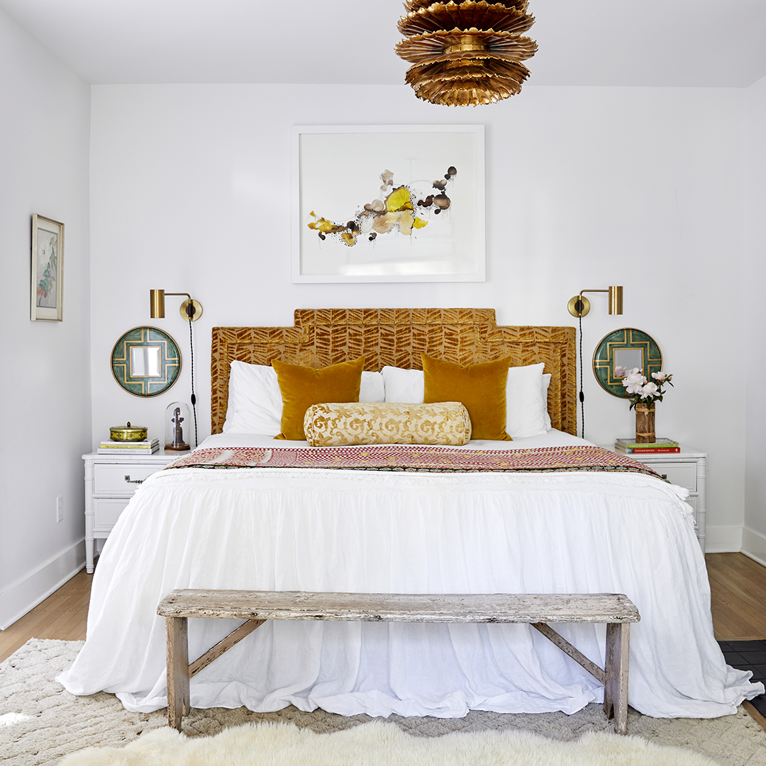 bed with plush headboard in master bedroom