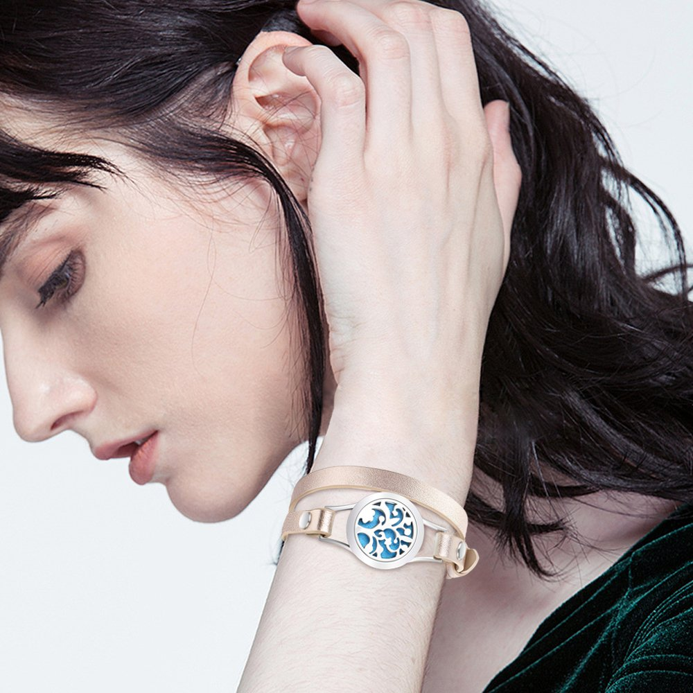 Woman wearing gold and blue bracelet