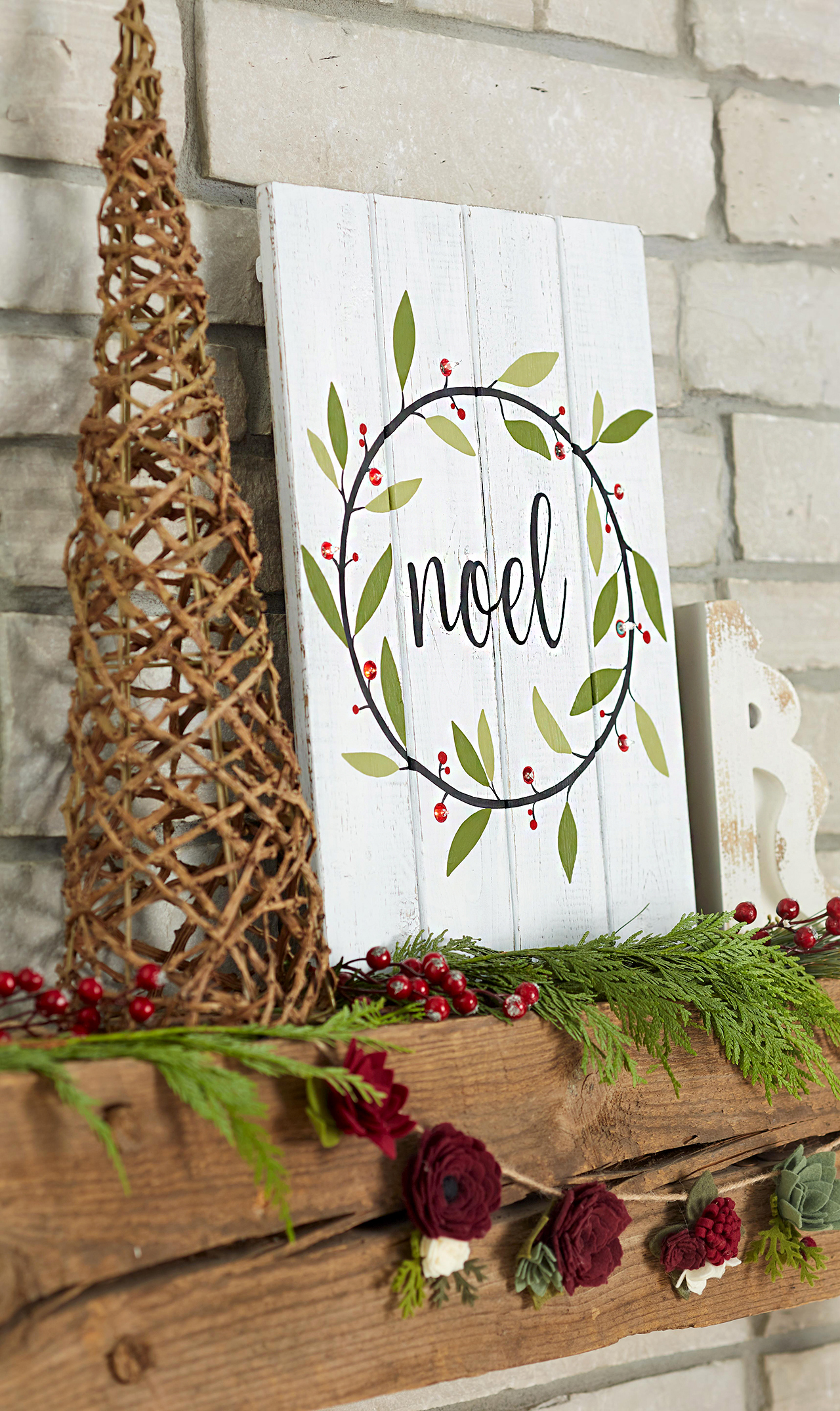 painted wood sign with lights and wreath design