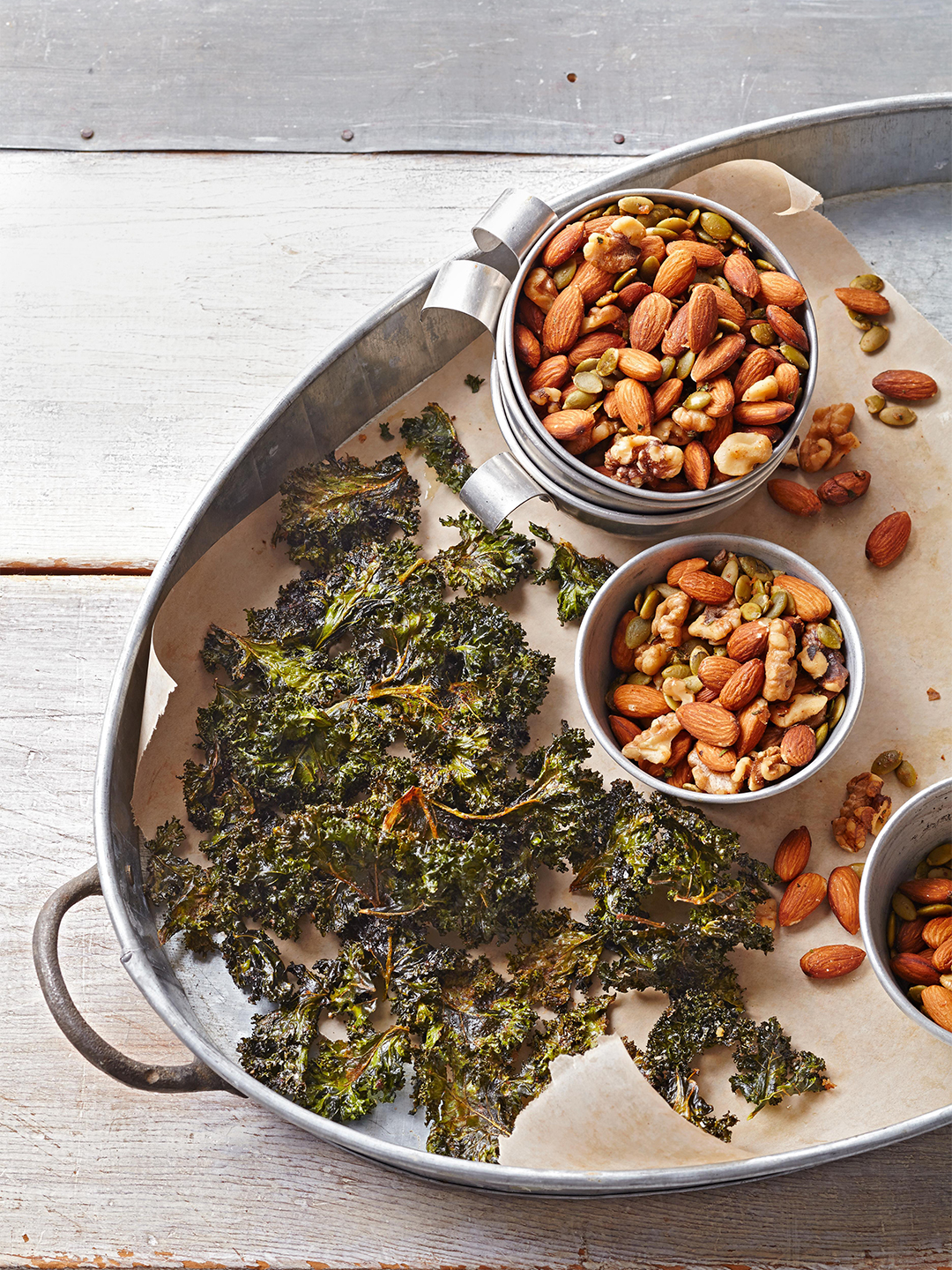Paleo Rosemary Roasted Nuts on metal serving tray