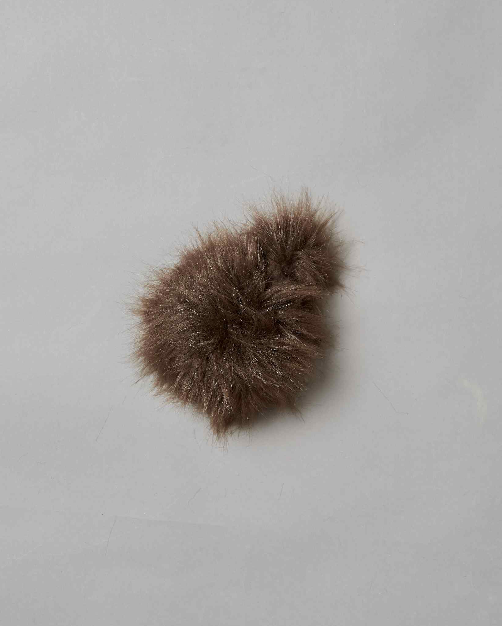Two foam balls covered in brown fur
