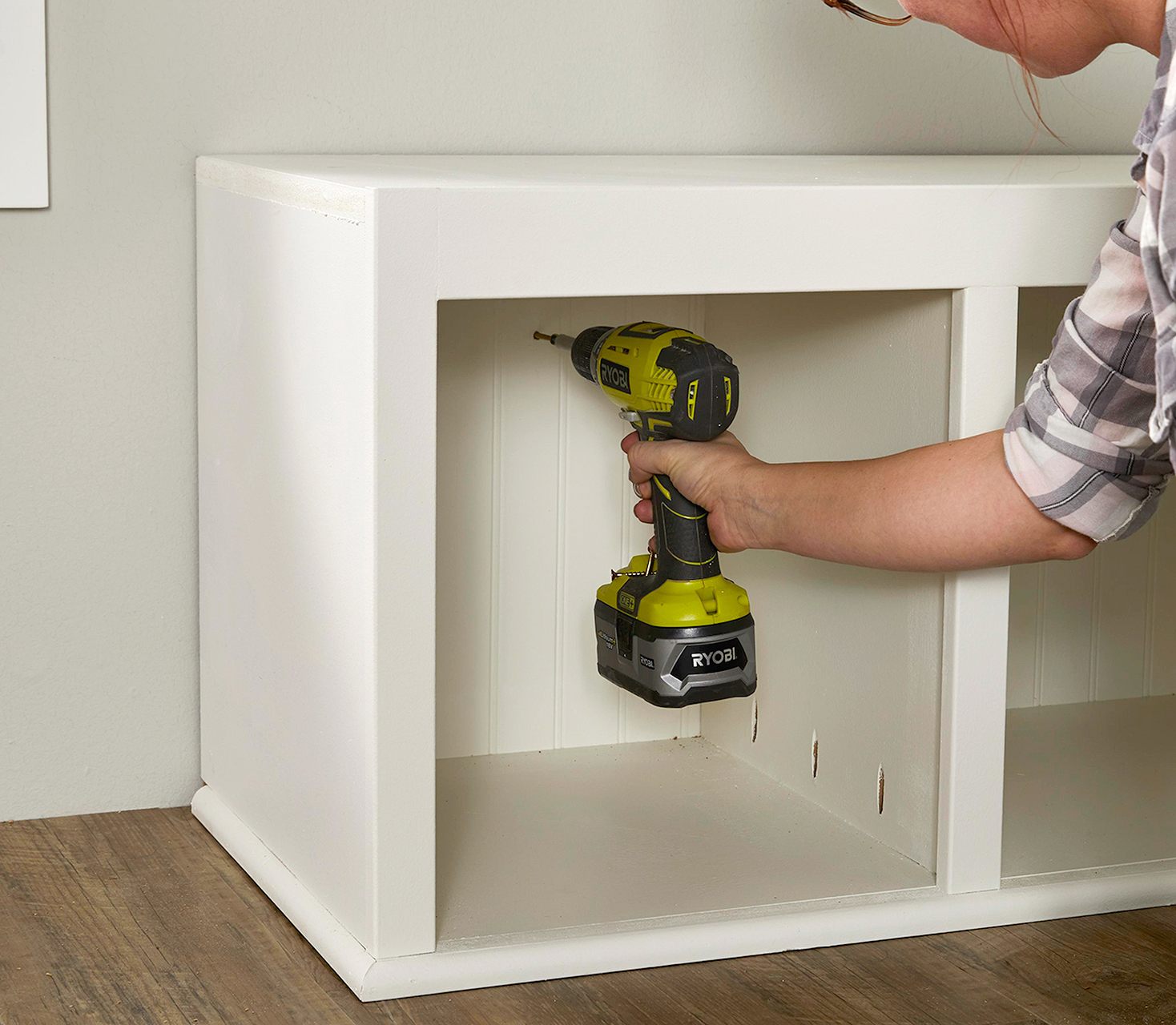 attach bench with screwdriver