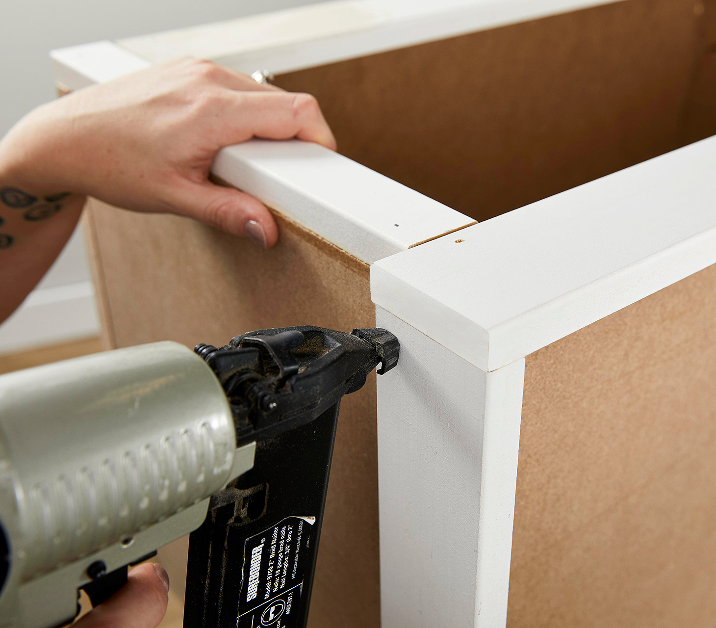 secure trimmed pieces with nail gun
