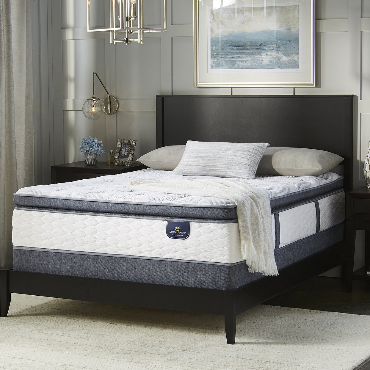 Mattress from Overstock with dark gray edging and white tufted sides and top