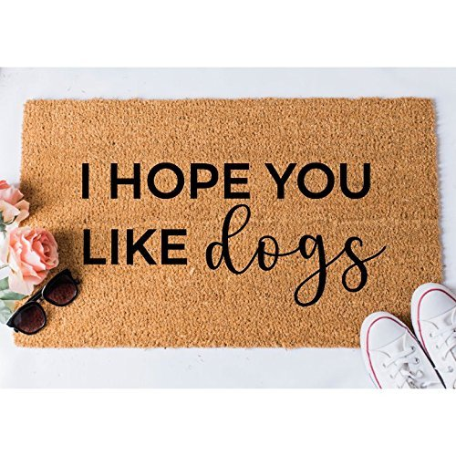 """Doormat that reads """"I hope you like dogs"""""""