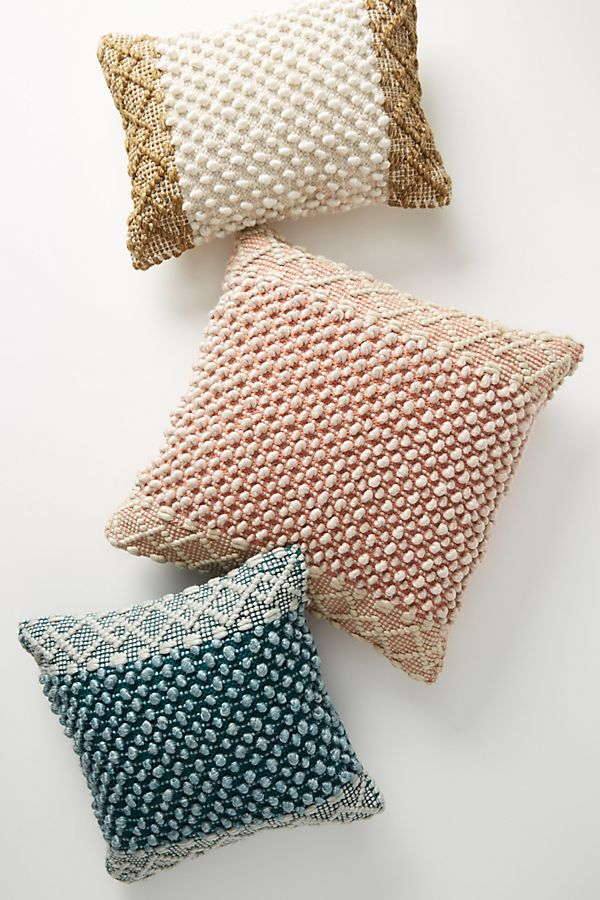 Textured throw pillows in jewel tones