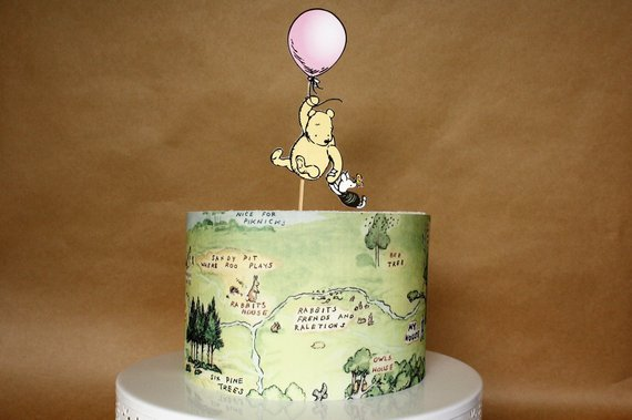 Cake with Winnie the Pooh cake the wrap (map of the Hundred Acre Woods) and Winnie the Pooh cake topper