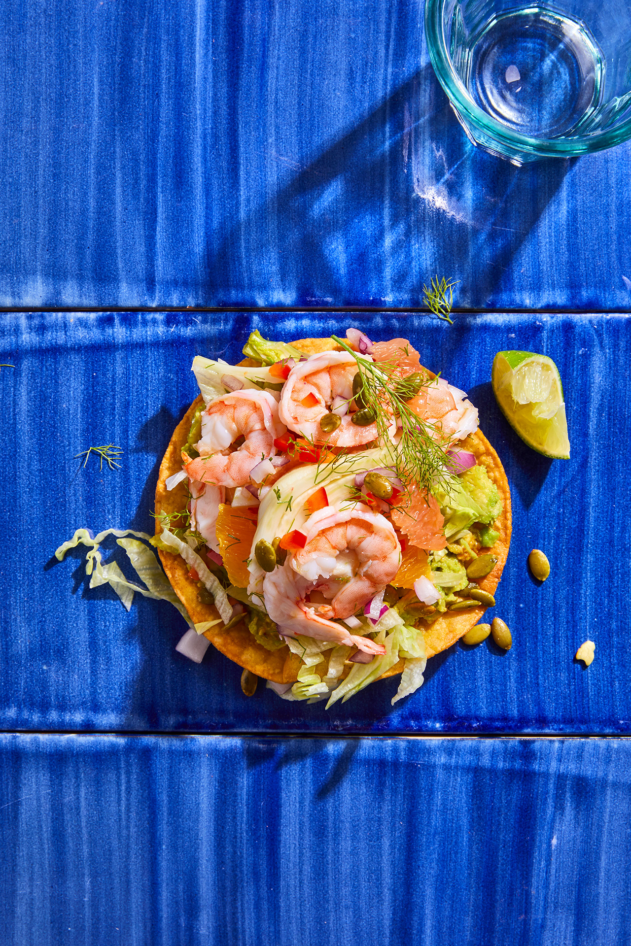 Shrimp Ceviche Tostada with Fennel and Grapefruit on blue counter