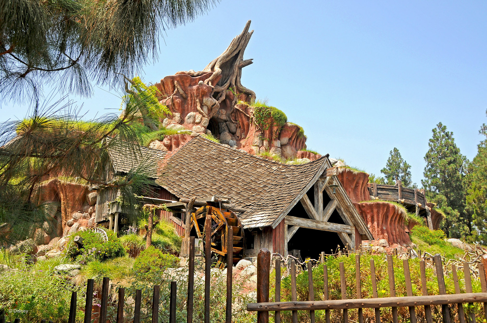 Red rock mountain and wild-west era buildings and fences around Splash Mountain Ride at Disneyland