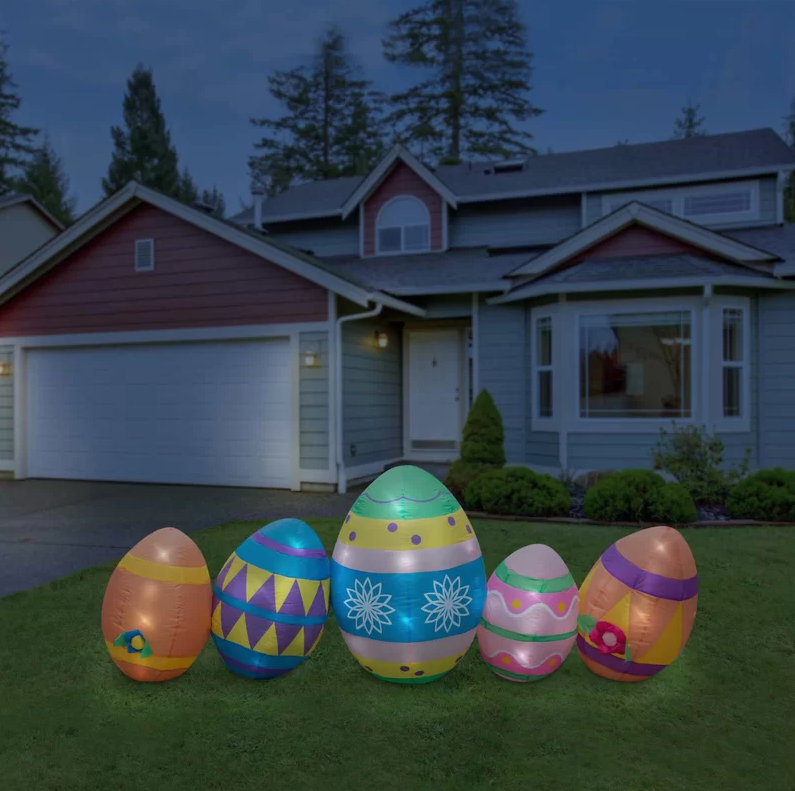 lighted giant easter egg inflatables in front lawn