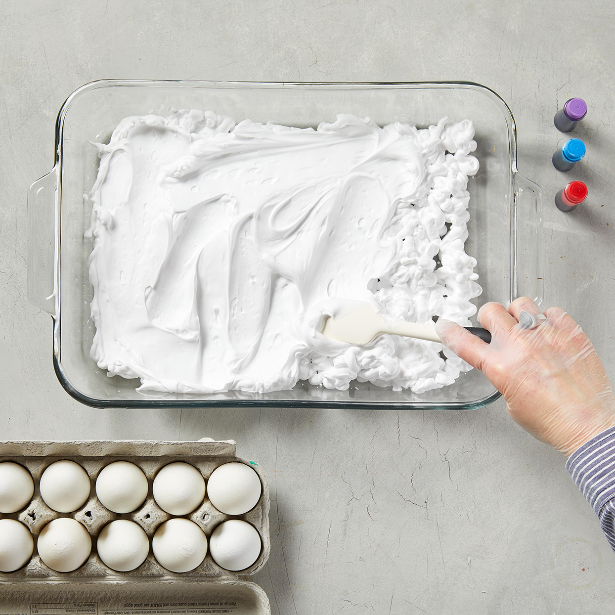 placing foam into glass dish for eggs