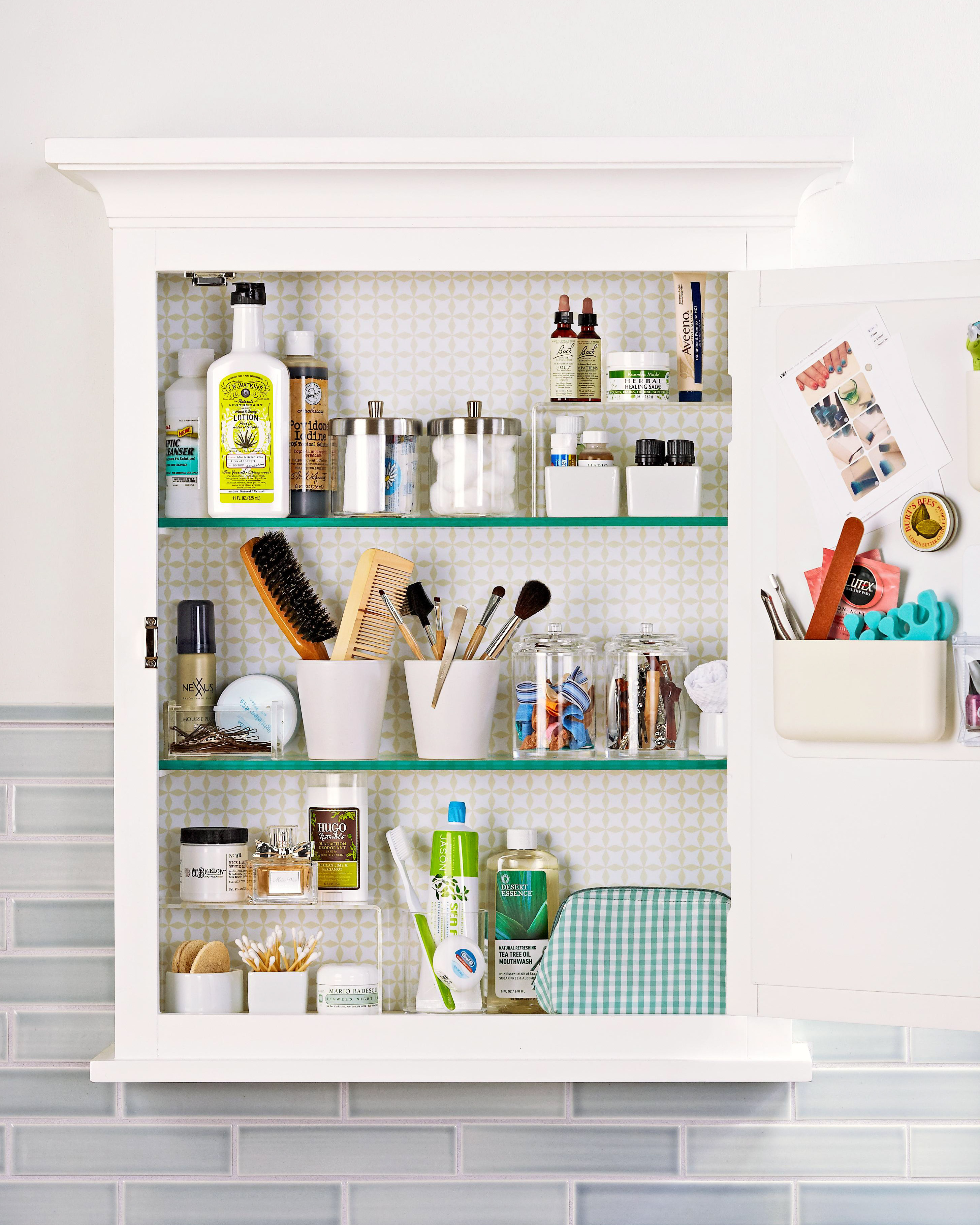 medicine cabinet fully stocked brushes combs toothpaste