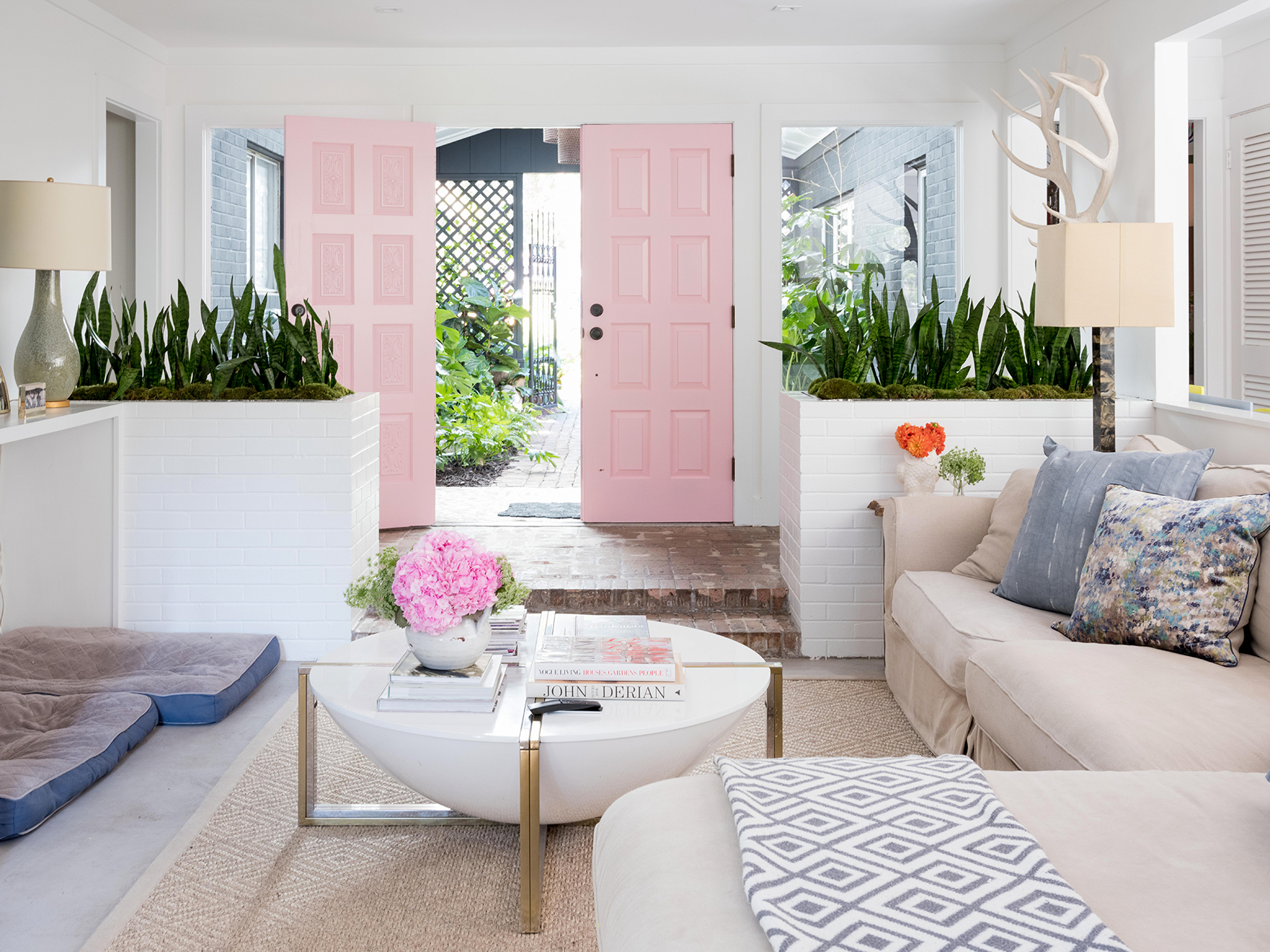 living room furniture with pink front doors