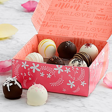 Pink and white patterned box filled with chocolate truffles