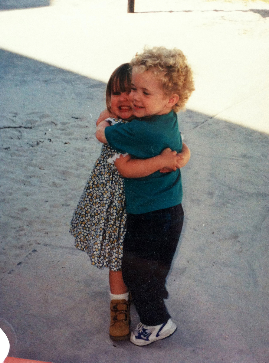 young kids hugging