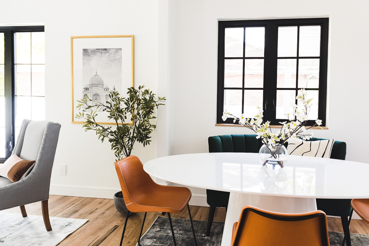 dining area living room with white table black windows