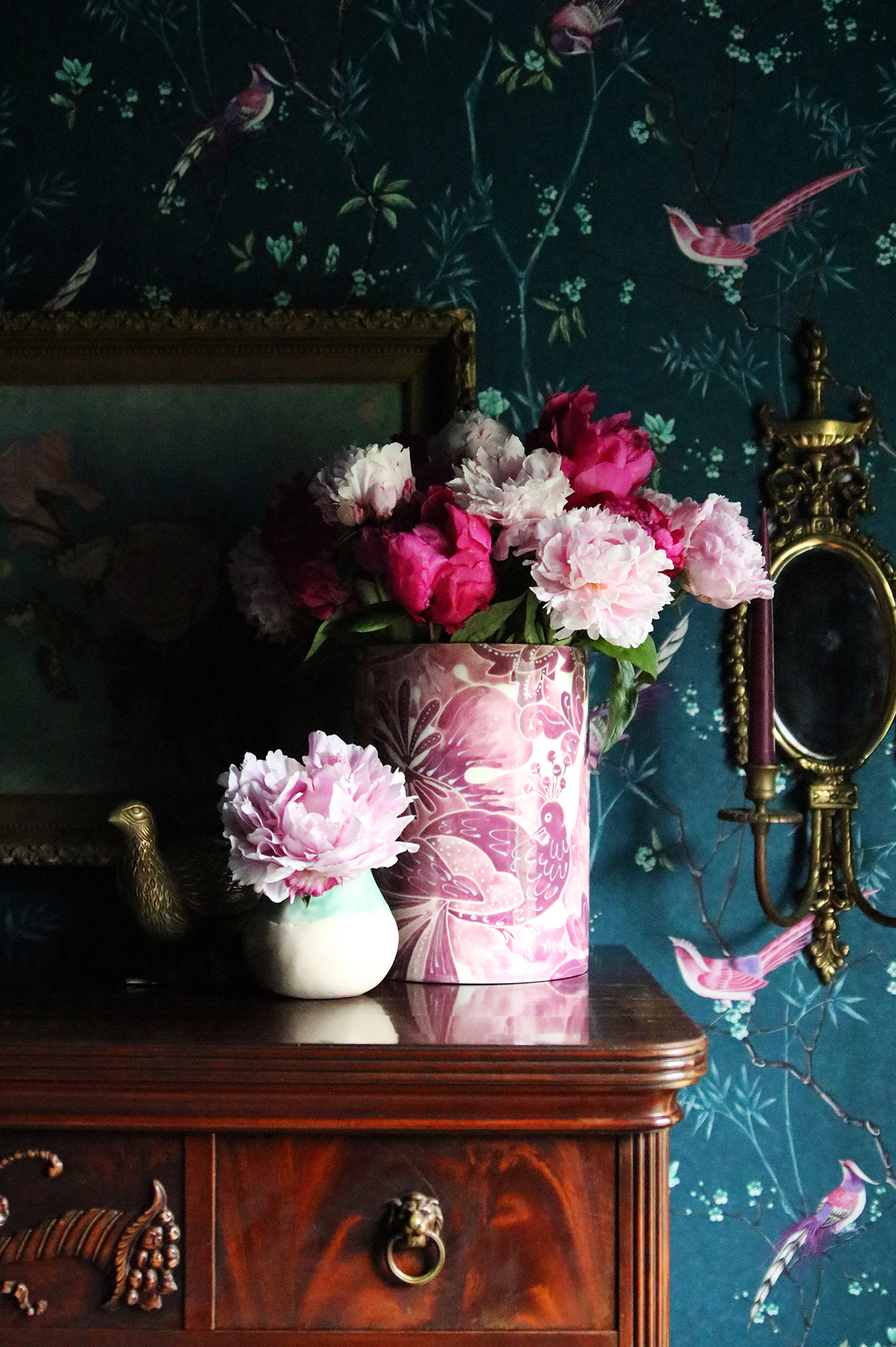 floral vases with peonies on antique dresser