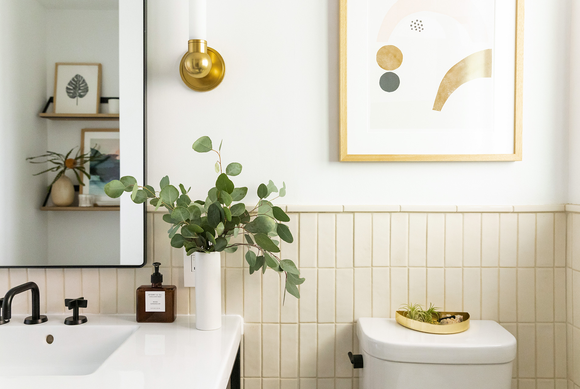 bathroom sink area with plant and home decor