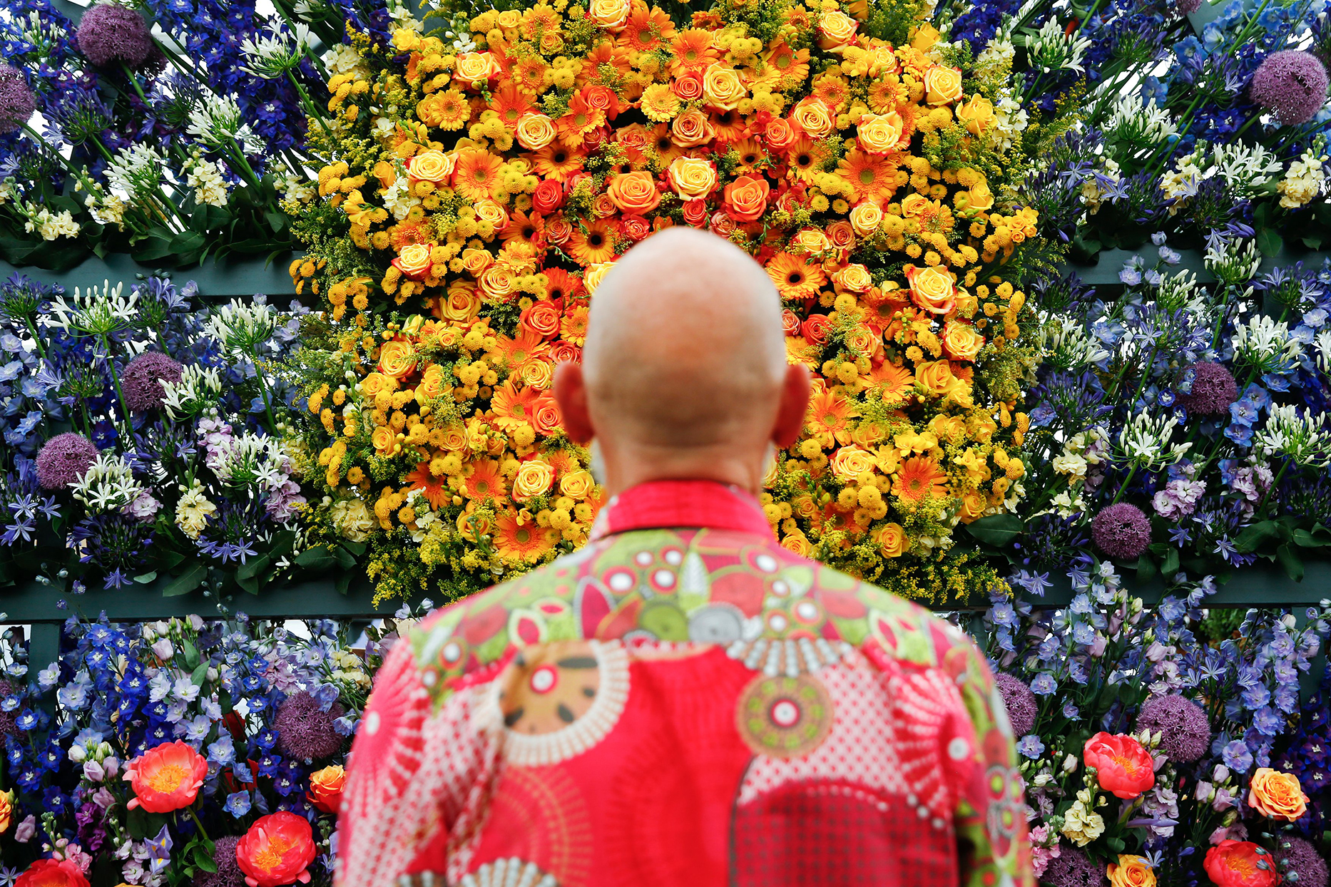 Designer John Sallis Chandler standing in front of his floral display at the Chelsea Garden Show