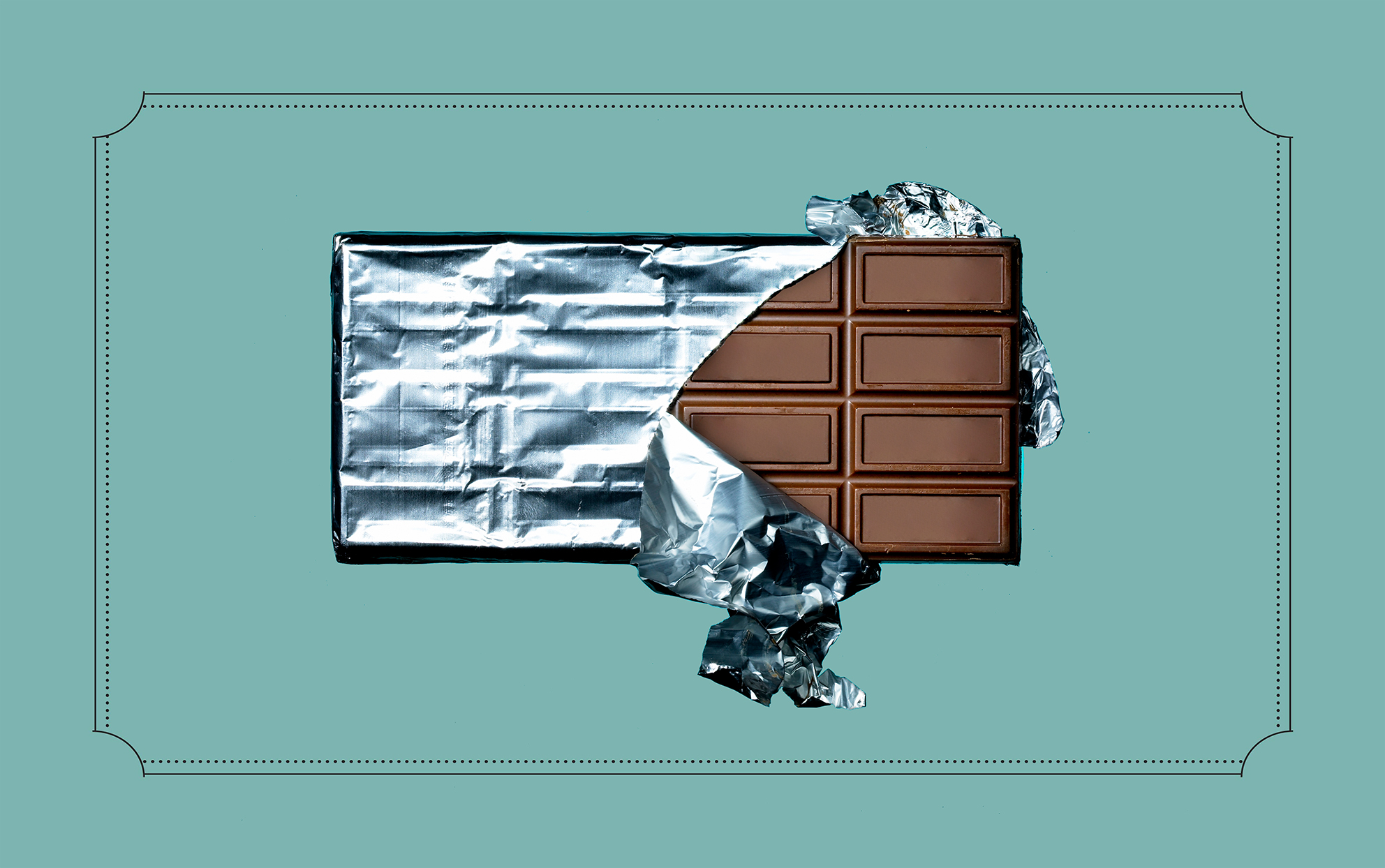 Hershey's milk chocolate bar foil wrapper being unwrapped to see blank squares of chocolate.