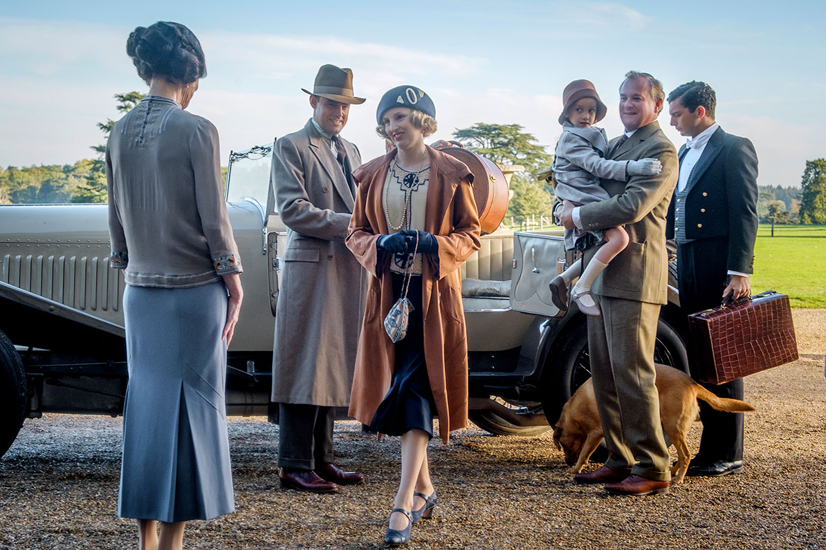 Cast of Downton Abbey getting out of a car