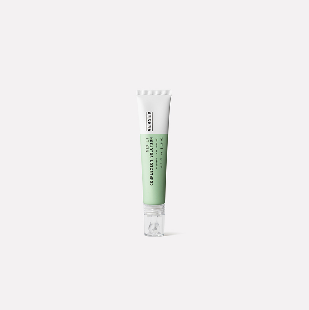 spot solution cream, green and white bottle
