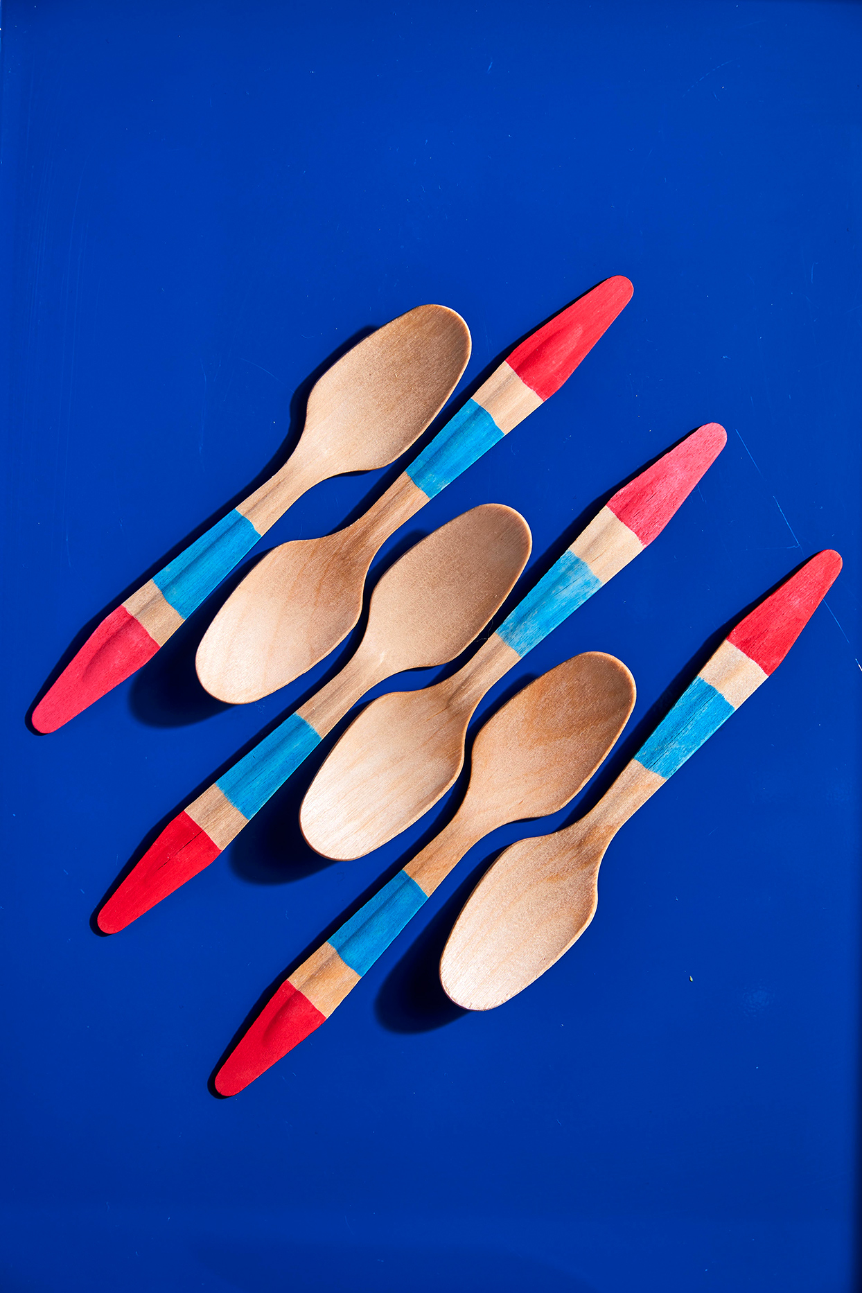 blue and red striped wooden spoons