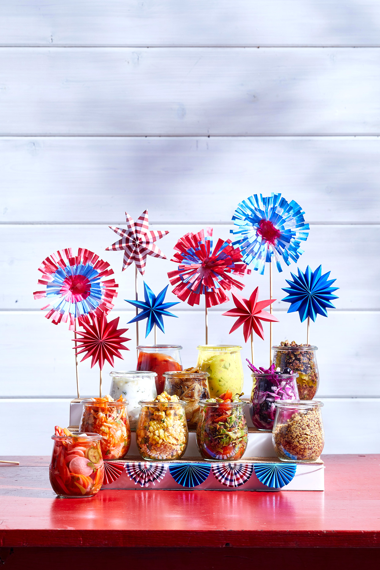 patriotic display of pinwheels and hotdog toppings