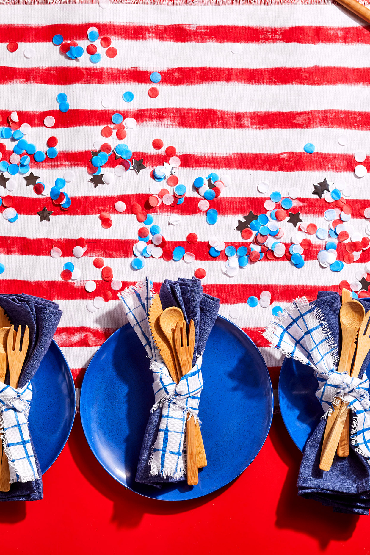 striped red table cloth confetti and blue plates