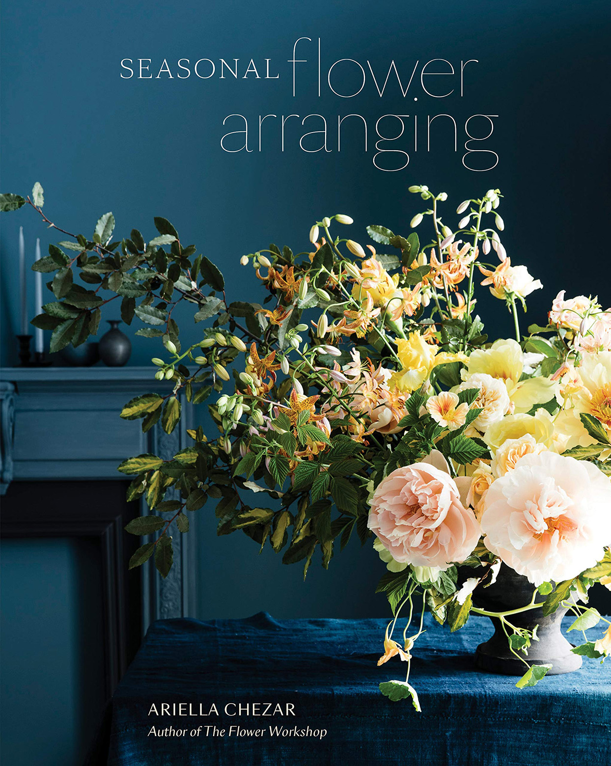 Seasonal Flower Arranging by Ariella Chezar hardcover book with blue background and pastel flower arrangement on cover