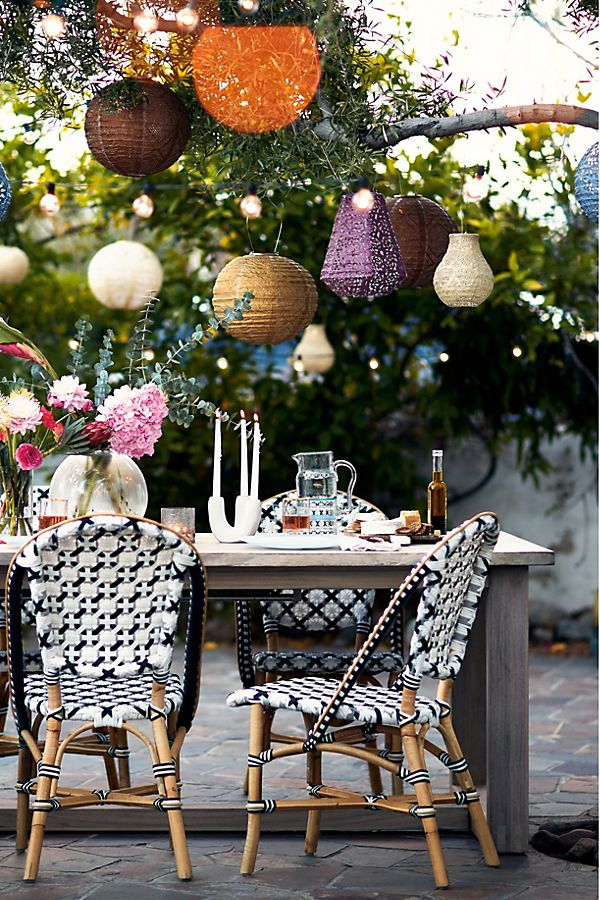 paper lanterns strung from trees