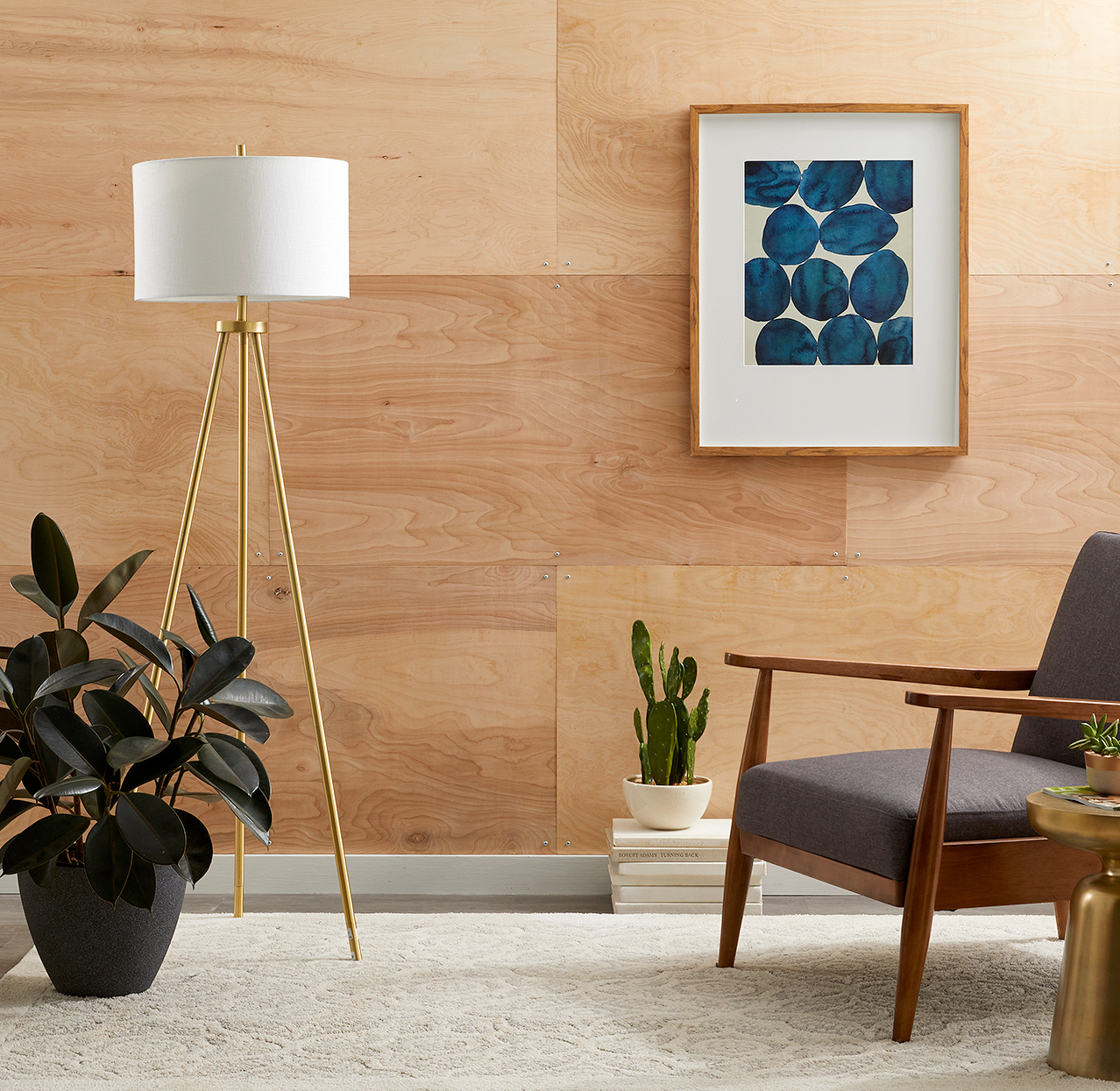 sitting area with plywood wall and decor