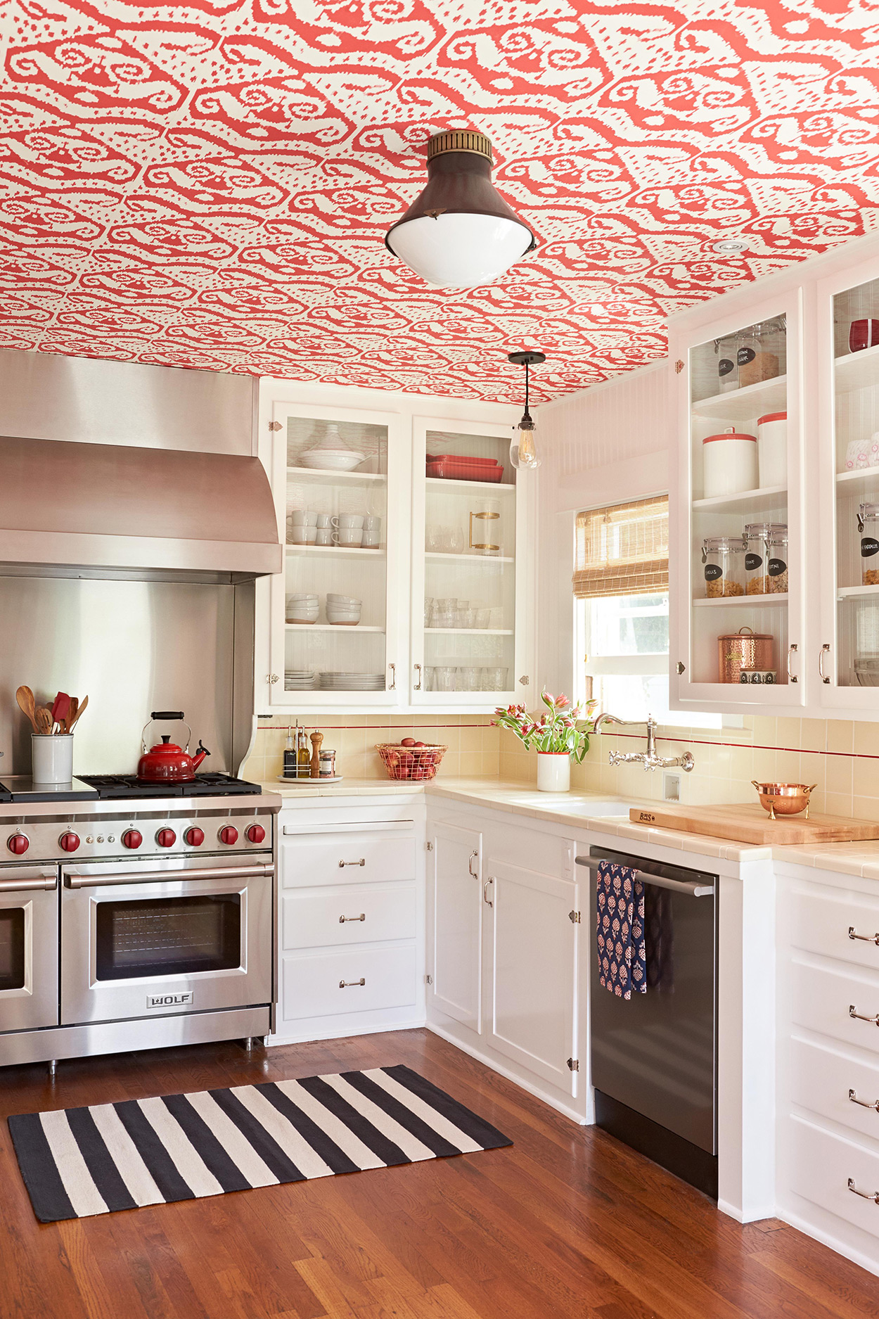red graphic wallpaper on retro kitchen ceiling