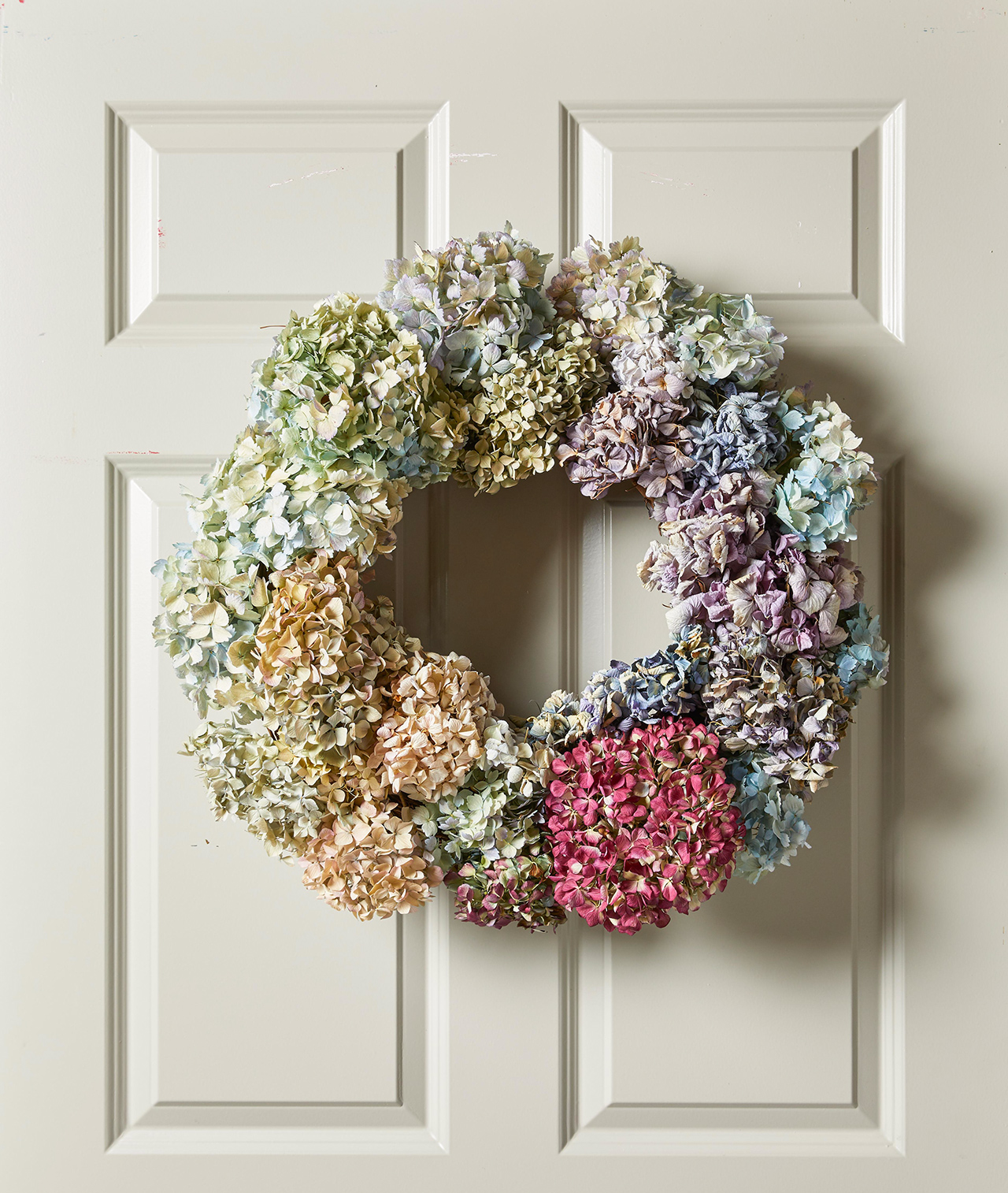 hydrangea blooms wreath hanging on door
