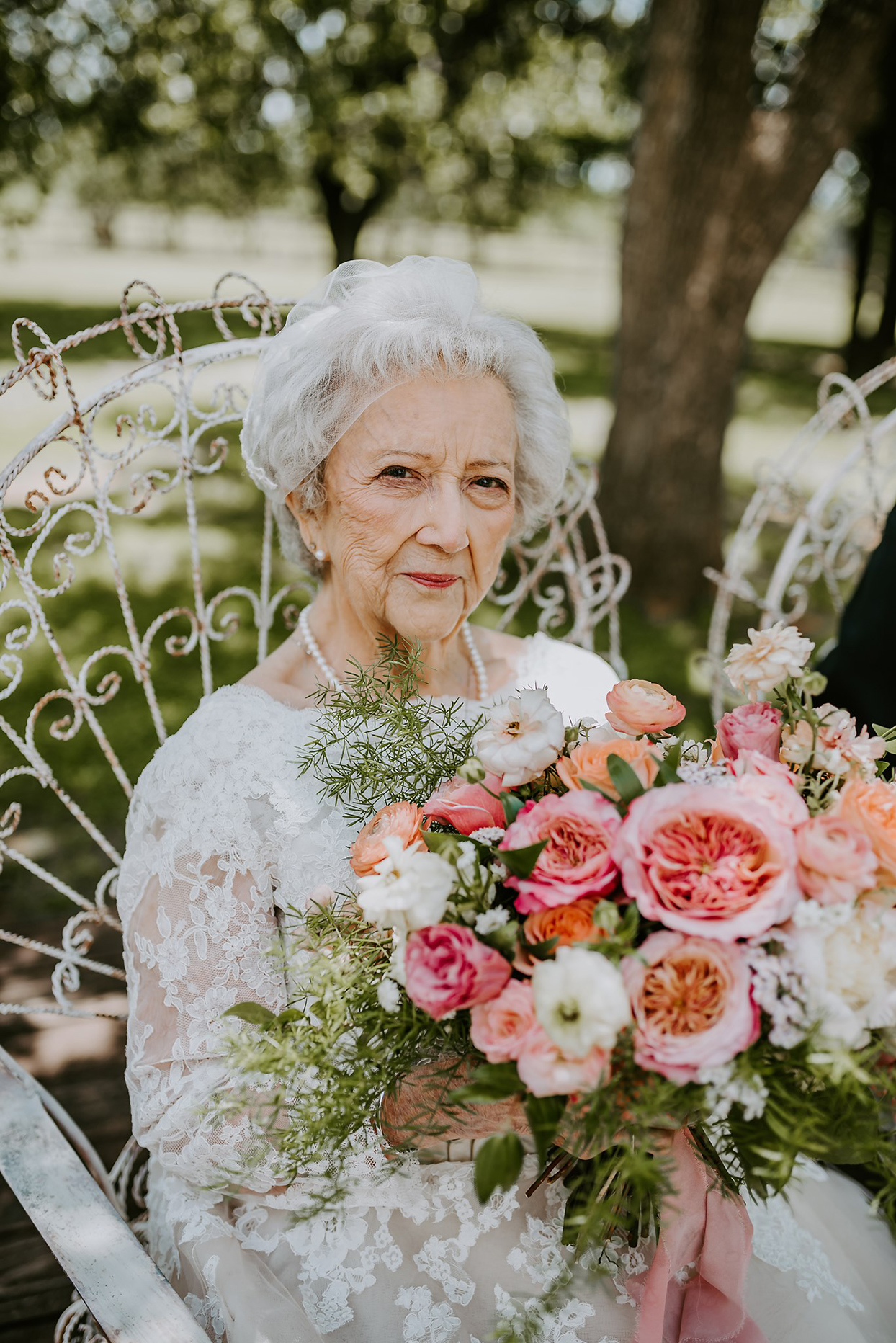 Carol Rutledge sitting outside with bouquet