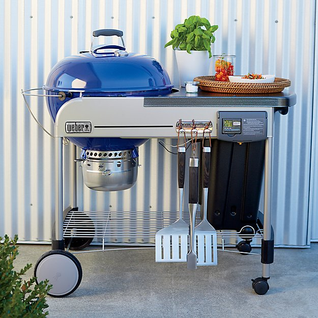blue weber grill on cement stab