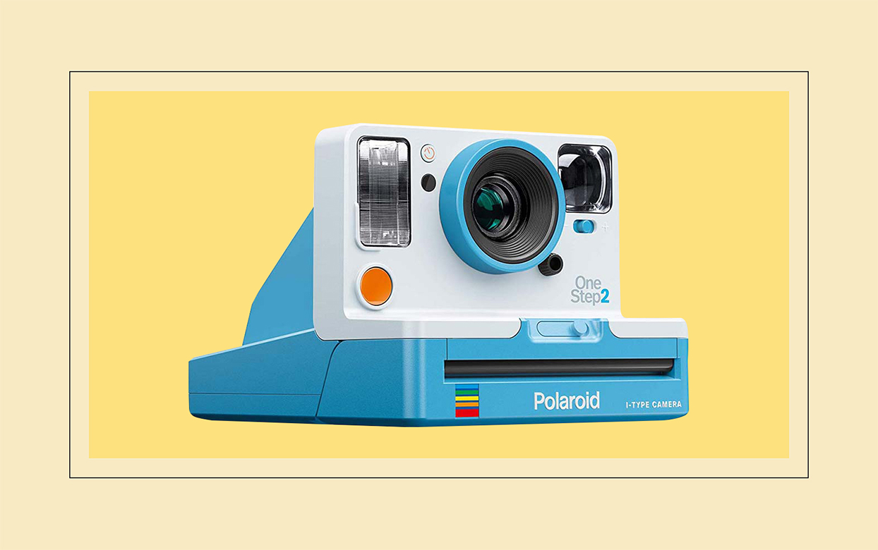polaroid camera on yellow background