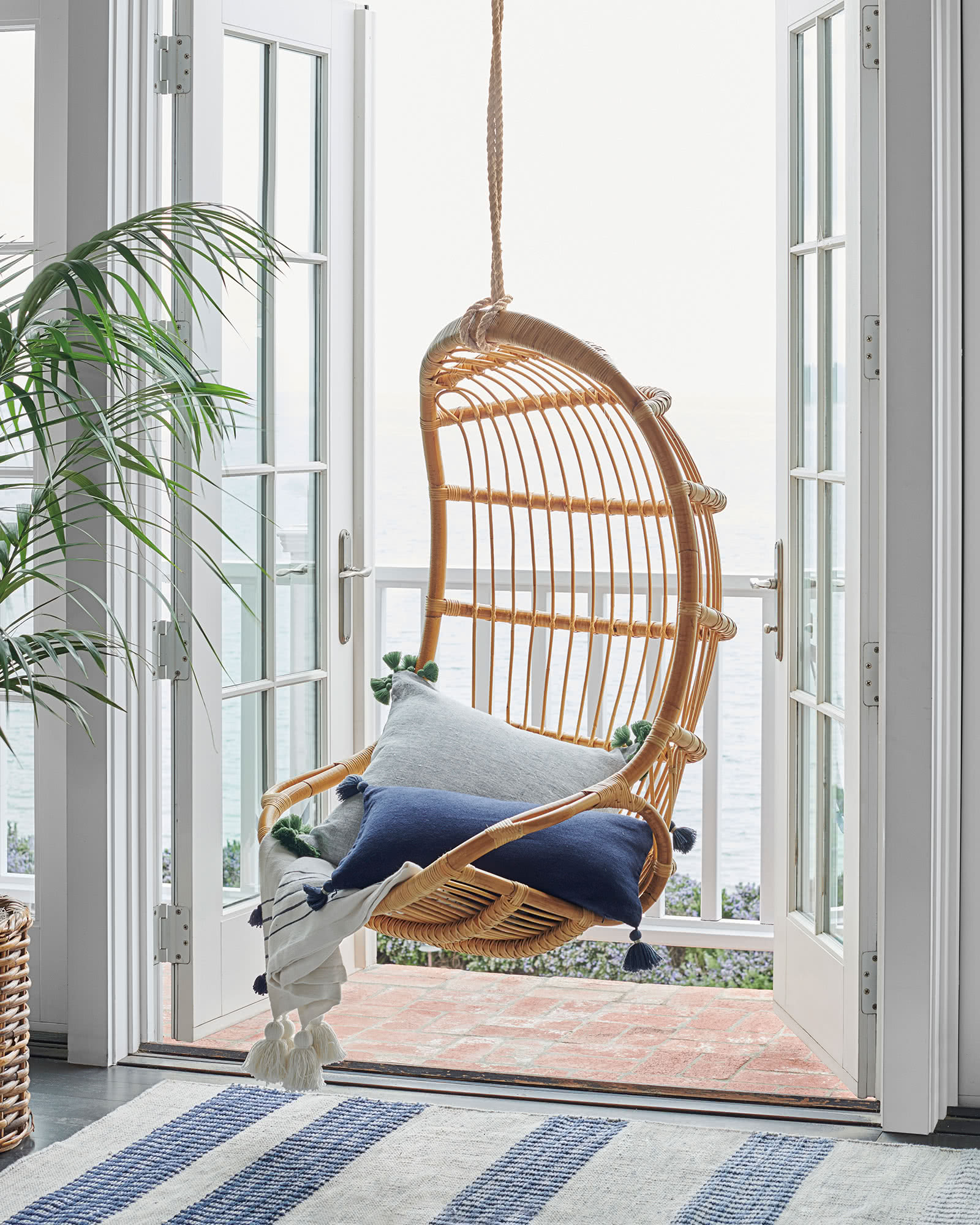 rattan hanging chair in window