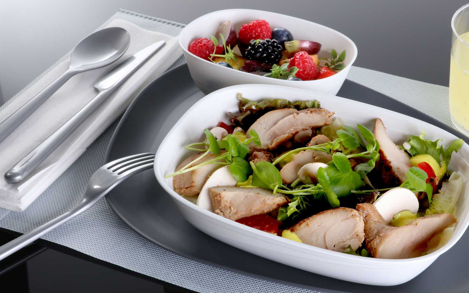 chicken salad and bowl of mixed fruit