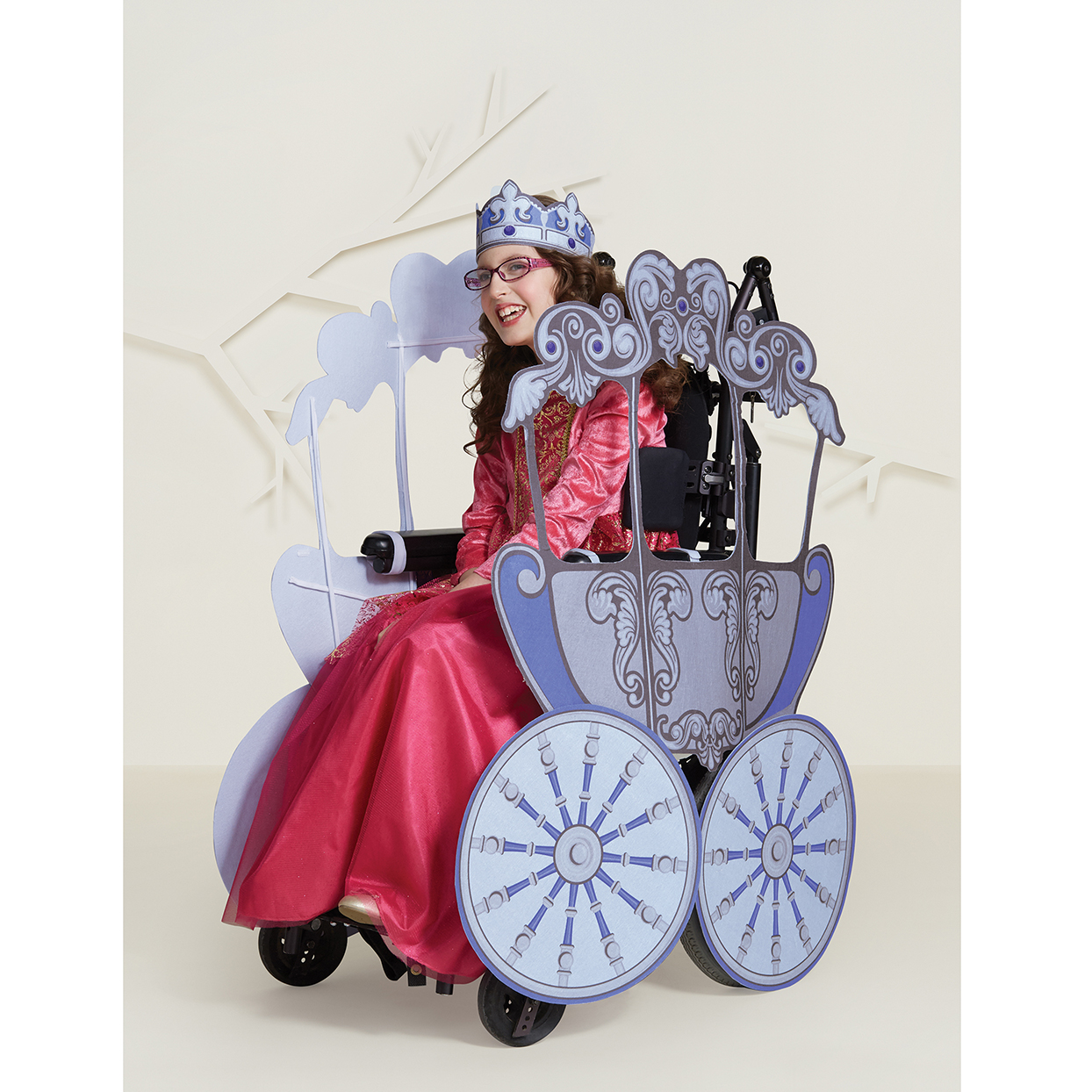 Target adaptive princess costume with girl in wheelchair decorate to look like purple carriage