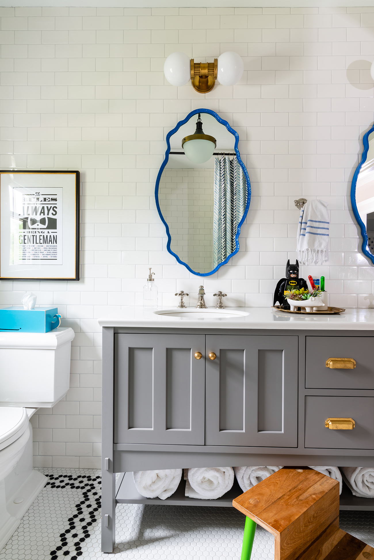 white bathroom with blue framed mirrors