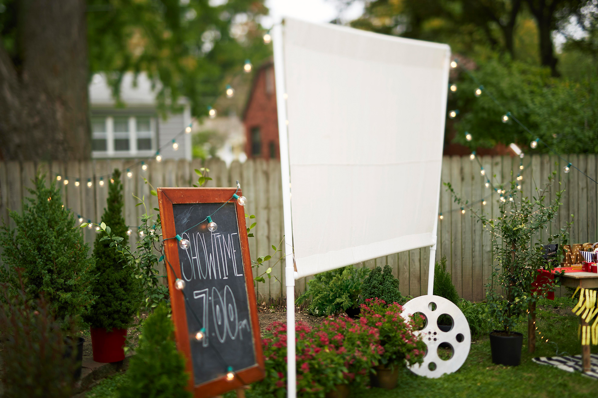 backyard movie screen projector reel showtime sign