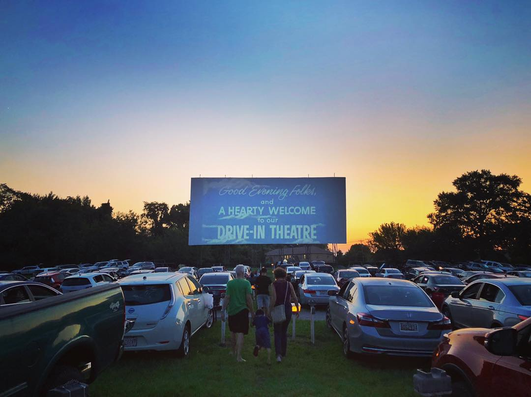 drive-in movie theater with people walking