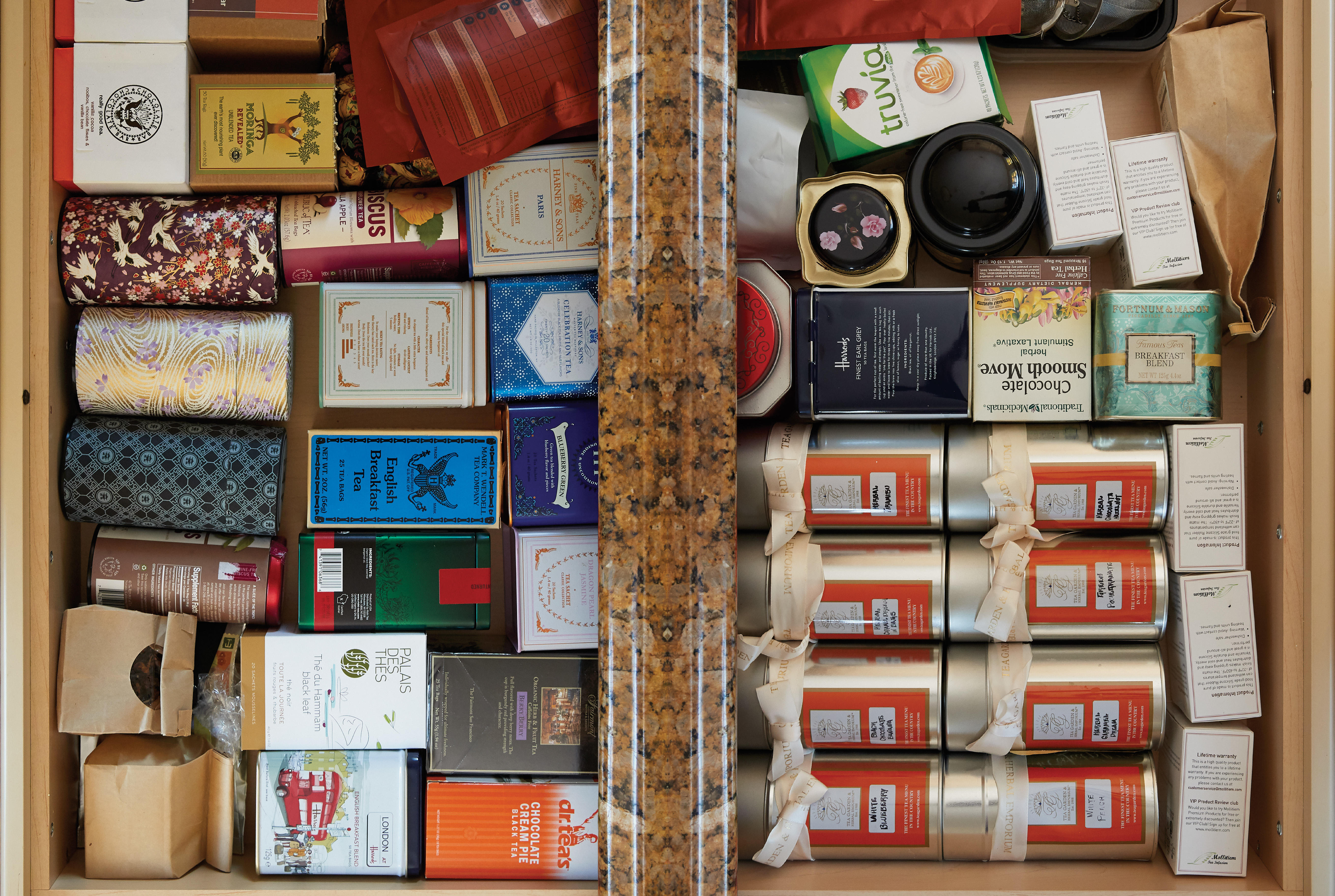 kitchen drawer open and filled with boxes of tea