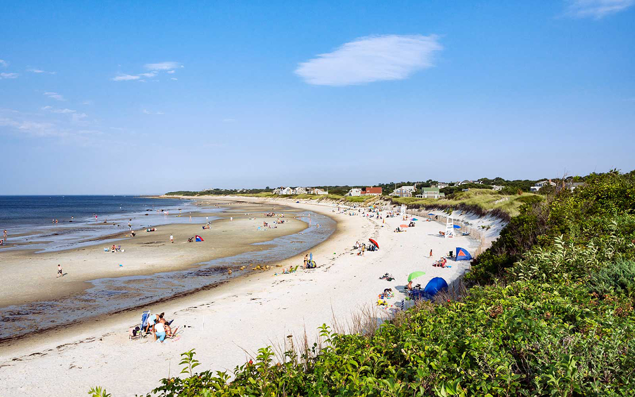 CAPE COD, DENNIS, MASSACHUSETTS, UNITED STATES - 2012/08/31: Vacationers at Corporation Beach.